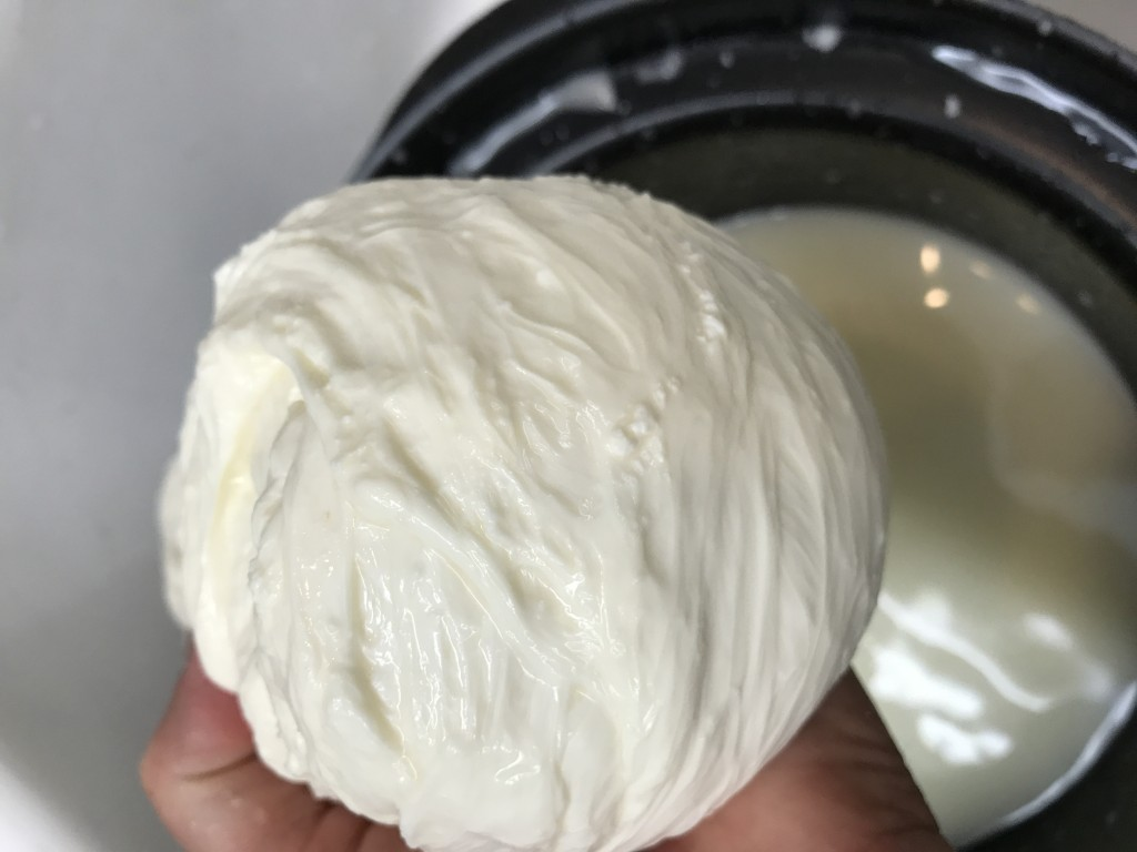 At this point, the cheese needs to be warmed to 135 degrees and stretched in order to become smooth.