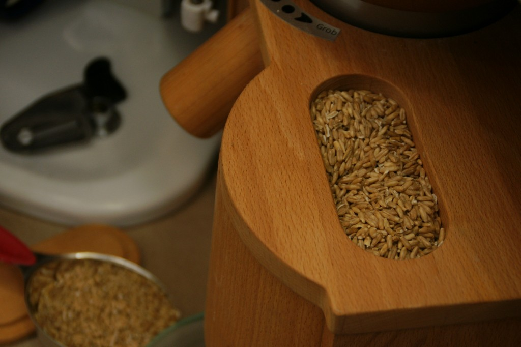 The whole spelt goes into the top of the hopper and can be ground into coarse or fine flour.