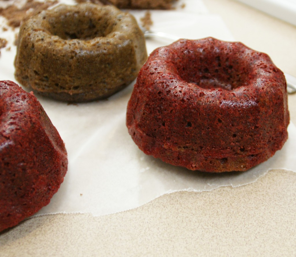 "Bundt cake with beets is in the background. It turned brown as the batter reaches a high temperature and starts to set up. Chocolate batter with added beets and red food coloring is in the foreground. For the recognizable ""red"" found in red velvet cakes, a little food coloring helps the batter maintain its bright color even when heated."